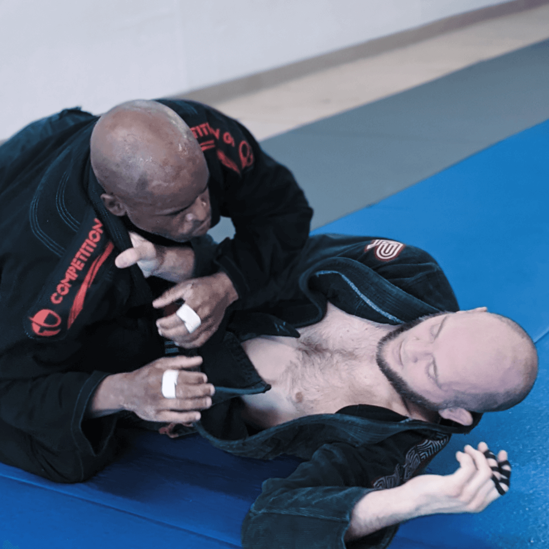 Coach Lance working to keep opponent in his guard